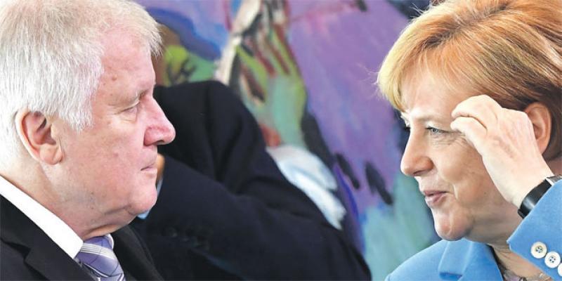 Politique migratoire: Merkel sur la sellette